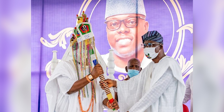 L-R: Lagos State Governor, Mr Babajide Sanwo-Olu (right), presents the Staff of Office to Oba Oniru of Iruland, Oba Abdul Wasiu Omogbolahan Lawal (Abisogun II), during the installation of the new Oba Oniru of Iruland, at Iru Palace, Victoria Island, on Sunday, June 7, 2020.